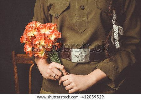 Soviet girl holding a carnation . The symbol of the Second World War - stock photo