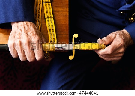 Soviet officer dagger in the hands of navy veteran. Memories. - stock photo