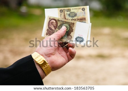 Soviet rubles in a hand. - stock photo