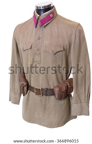 Soviet (Russian) soldier's blouse (M35) from the WWII period. Also could see officer belt and rifle ammunition on the belt. - stock photo