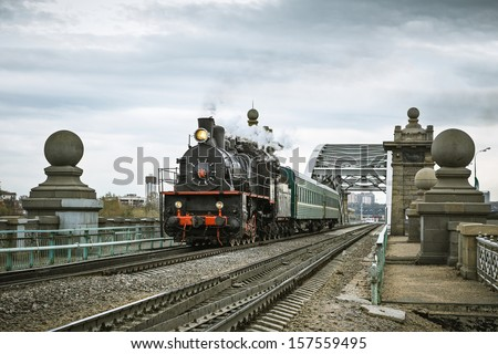 Soviet steam locomotive and bridge. - stock photo