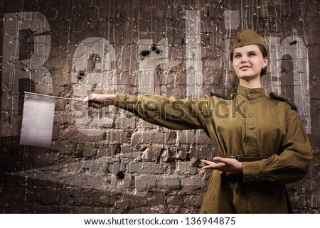 Soviet traffic controller in uniform of World War II indicates the direction - stock photo