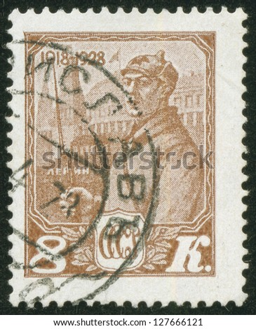 SOVIET UNION - CIRCA 1928: A stamp printed by the Soviet Union Post shows a red army soldier in a Budenny cap, circa 1928