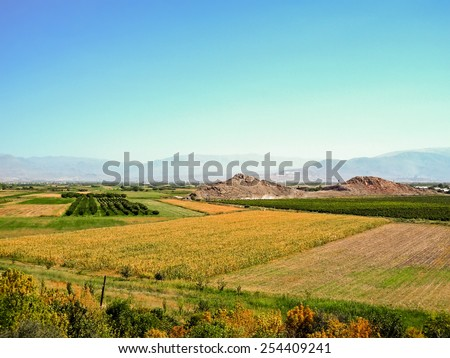 Sowed and tilled fields in Armenia - stock photo