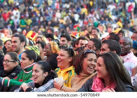 SOWETO - JUNE 10: Fans watch international performers at Orlando Stadium for the FIFA World Cup Kick Off Celebration Concert on June 10, 2010 in Soweto. - stock photo