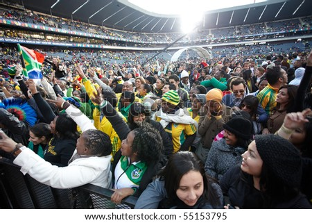 SOWETO - JUNE 10: Fans watches international performers at Orlando Stadium for the FIFA World Cup Kick Off Celebration Concert on June 10, 2010 in Soweto. - stock photo