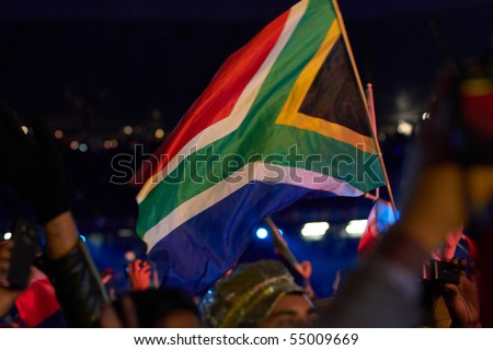 SOWETO - JUNE 10: Fans waves National Flags During the Football Anthem by K'naan at Orlando Stadium for the FIFA World Cup Kick Off Celebration Concert on June 10, 2010 in Soweto. - stock photo