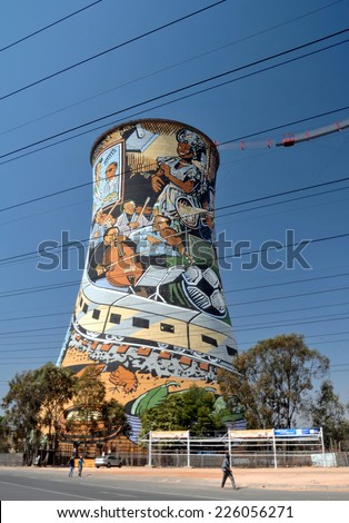 SOWETO, SOUTH AFRICA - SEPTEMBER 26 : Painted chimney pair at 26, September, 2014 at Soweto, South Africa. The painted chimney is the world famous landmark of Soweto, the slum of Johannesburg. - stock photo