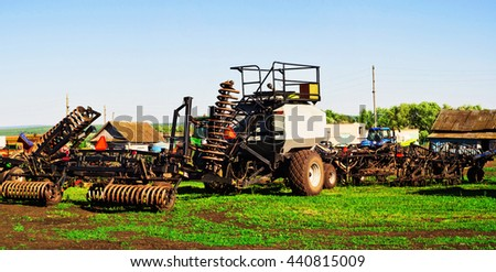 Sowing machine with seeding and plowing tools for planting season - stock photo