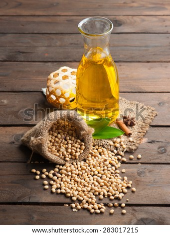Soy bean and soy oil on wooden,Selective focus with shallow depth of field. - stock photo