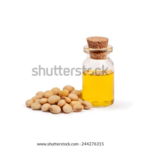 Soy beans and oil isolated on white - stock photo