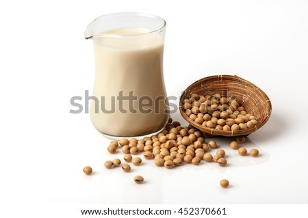Soy beans and soy milk in a glass. - stock photo