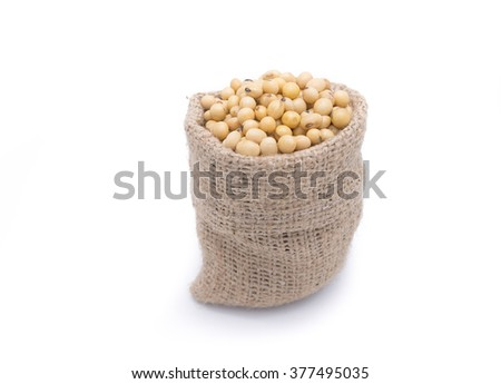 Soy beans in gunny bag isolated on white background - stock photo