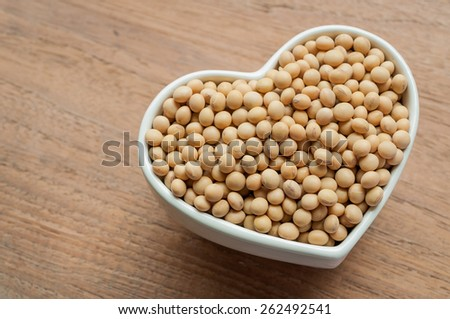 Soy beans on wooden desk - stock photo