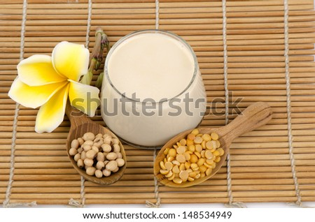 Soy beans, soy milk in a glass and soybeans.seeds. (Glycine max (L.) Merr.). - stock photo