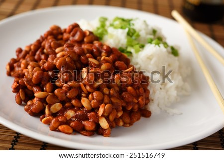 Soy beans with rice and green onion - stock photo