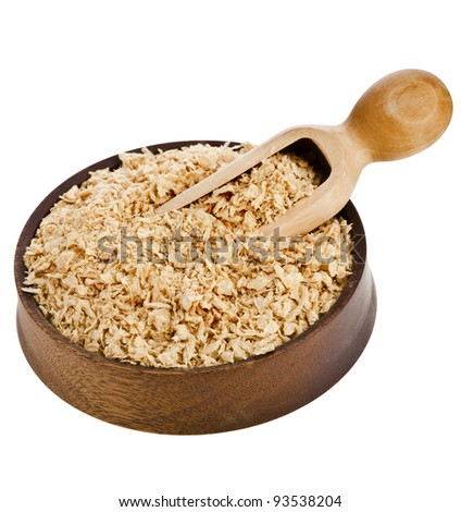 soy meat flakes in wooden bowl  isolated on white background