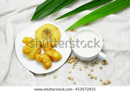 soy milk and deep fried dough stick with bean on table, soy milk,soy bean, dough stick