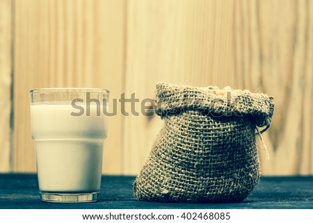 Soy milk and soy bean. Retro filter - stock photo