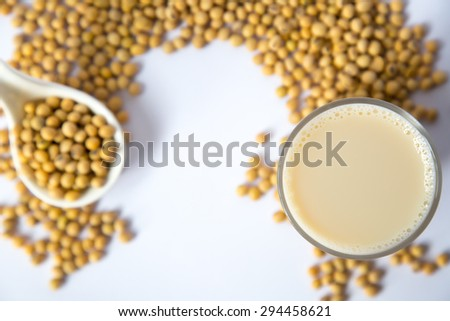Soy milk glass and soy beans with white background - stock photo