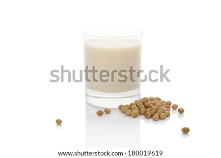 Soy milk in glass with soya beans isolated on white. Vegan milk concept. - stock photo