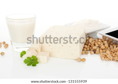 Soy milk, tofu, soybeans, granules and soy sauce isolated on white background. Culinary vegetarian and vegan eating background. - stock photo