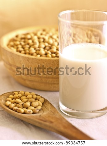 soy milk with beans in spoon - stock photo