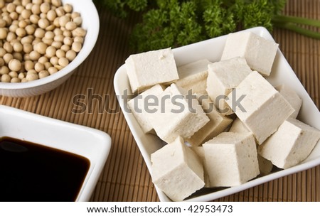 Soy products assortment: cheese, sauce and beans. - stock photo