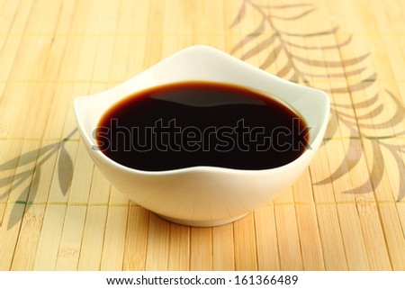 Soy Sauce in bowl - stock photo