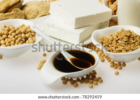 Soy sauce with other products made from soybean over white background - stock photo