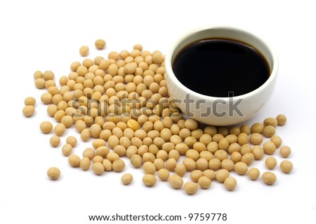 Soy sauce with soy beans - stock photo