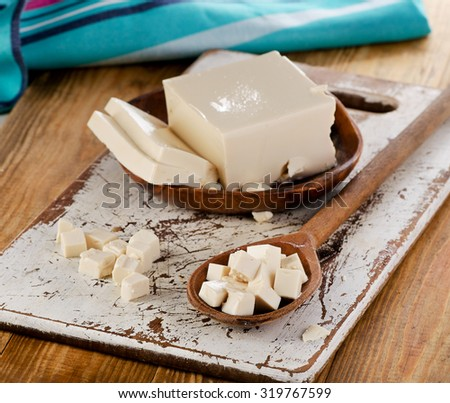Soy Tofu on a wooden Background. Selective focus - stock photo