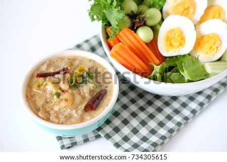 soya bean dipping sauce with boiled eggs and vegetable on white background. Thai food.