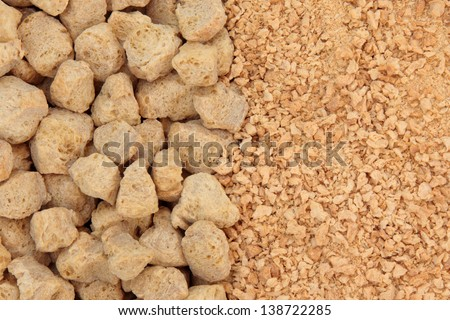 Soya chunks and flakes forming a background. - stock photo