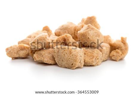 Soya chunks isolated on white background. Closeup. - stock photo