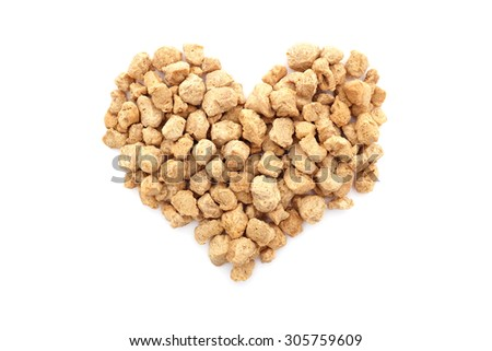 Soya protein chunks in a heart shape, isolated on a white background - stock photo