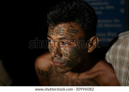 SOYAPANGO, EL SALVADOR, February 8, 2008. Mara Salvatrucha-13 gang member captured in  El Salvador on February 8, 2008 in Soyapango, reportedly one of the most dangerous areas of El Salvador. - stock photo
