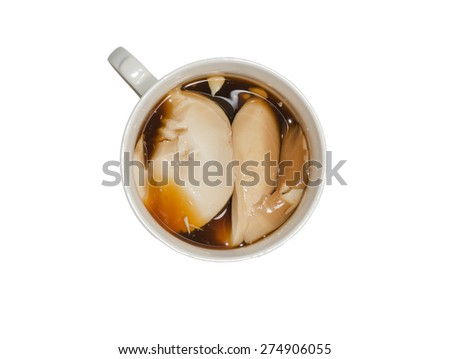 soybean curd with black sugar in a mug on white background - stock photo