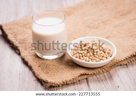 Soybeans and soy milk in a glass. - stock photo