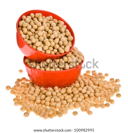 Soybeans  in orange plastic bowls on a white background. - stock photo