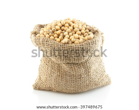 Soybeans or soya beans in a sack isolated on white background, natural source of protein - stock photo