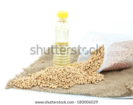 soybeans with oil on white background - stock photo