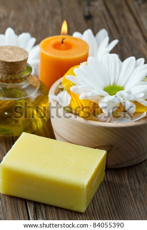 spa accessories on wood table - stock photo