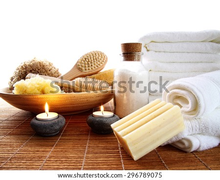 Spa accessories with lit candles and towels - stock photo
