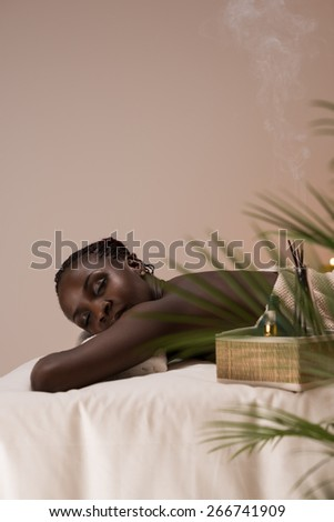 Spa African Woman in Beauty Salon Relaxing - stock photo