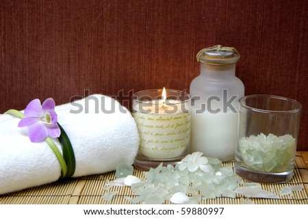 Spa and beauty treatment. Soothing therapy with seasalt in bowl - stock photo