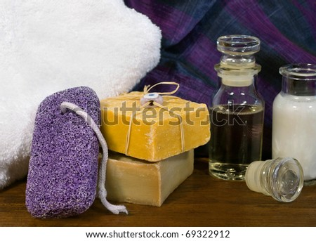 Spa and skincare products including handmade soaps, pumice stone and essential oils. - stock photo