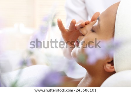 Spa and wellness relaxing facial massage.  - stock photo