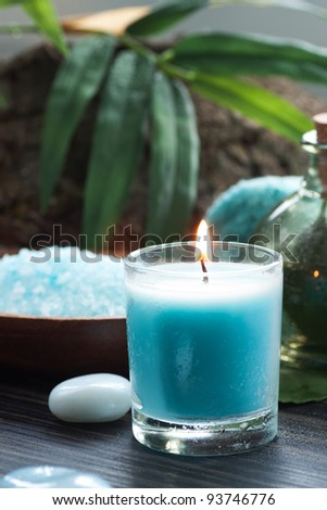 Spa and wellness  setting with bath salt, candles and towel. Blue dayspa nature set - stock photo