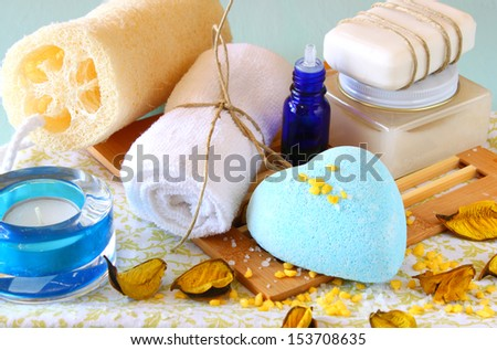 Spa and wellness setting with natural soap, candles and towel. aqua wooden background   - stock photo